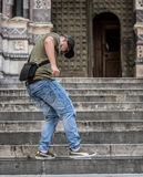 Angry guy stomping on his tablet. A young Italian guy angry at his old tablet, trying to stomp on it and destroying it his feet Royalty Free Stock Photos