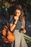 Young Italian woman with a backpack stock image