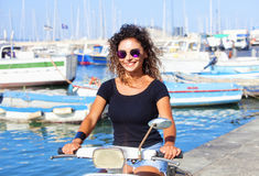 Young Italian Woman on Scooter Stock Images