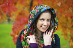 Young Italians in a beige coat and knit a scarf on her head Stock Photography