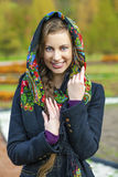 Young Italians in a beige coat and knit a scarf on her head Stock Image