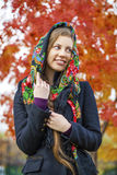 Young Italians in coat and knit a scarf on her head Stock Images