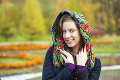 Young Italians in coat and knit a scarf on her head Stock Photos