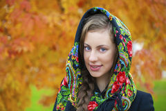 Young Italians in coat and knit a scarf on her head Royalty Free Stock Photo