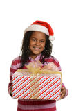 Young jamaican girl holding christmas gift Royalty Free Stock Photography