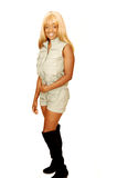 Young Jamaican girl safari overall 89. An blond young Jamaican girl in an safari overall and long brown boots Stock Photo