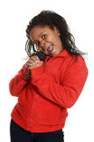 Young jamaican girl singing Stock Images