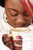 Young Jamaican woman with coffee. Stock Photo