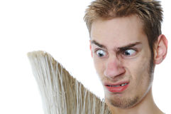 Young Janitor Grossed out Royalty Free Stock Photo