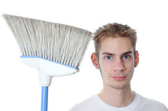 Young Janitor Smiling with Broom Stock Photo