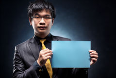 Young japan businessman with blank page. Contrast colors Stock Image