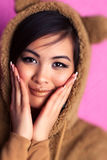 Young japan woman in bear suit Stock Photography