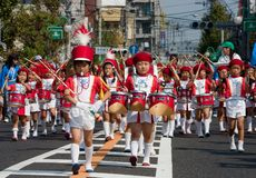 Young Japanese boy leads a  marching band. KAGOSHIMA CITY, JAPAN - OCTOBER 22: A young boy leads a  elementary school marching band  during the Taniyama Royalty Free Stock Photography