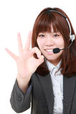 Young Japanese businesswoman of call center with head sets  showing perfect sign Stock Photography
