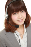 Young Japanese businesswoman of call center with head sets Royalty Free Stock Image