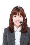 Young Japanese businesswoman of call center with head sets Stock Image