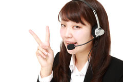 Young Japanese businesswoman of call center with head sets Royalty Free Stock Photo