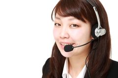 Young Japanese businesswoman of call center with head sets stock photography
