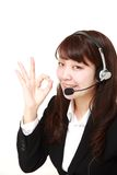 Young Japanese businesswoman of call center with head sets Royalty Free Stock Photos