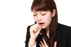 Young Japanese businesswoman coughing Royalty Free Stock Photography