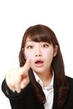 Young Japanese businesswoman discover something. Studio shot of young Japanese woman on white background stock image