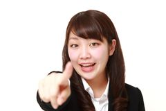 Young Japanese businesswoman discover something. Studio shot of young Japanese woman on white background Stock Photo