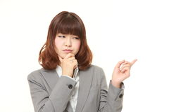 Young Japanese businesswoman doubting Stock Photo