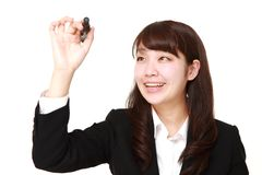 Young Japanese businesswoman draw in the air Royalty Free Stock Photography