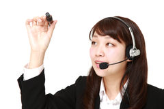 Young Japanese businesswoman draw in the air Stock Image