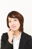 Young Japanese businesswoman dreaming at her future Royalty Free Stock Photography