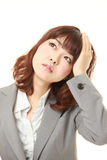 Young Japanese businesswoman has lost her memory Royalty Free Stock Photography