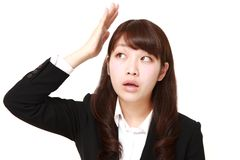 Young Japanese businesswoman has lost her memory Royalty Free Stock Images