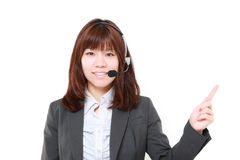 Young Japanese businesswoman presenting and showing something Stock Image