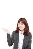 Young Japanese businesswoman presenting and showing something. Studio shot of young Japanese businesswoman on white background stock images