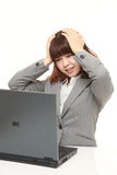 Young Japanese businesswoman shocked Royalty Free Stock Images