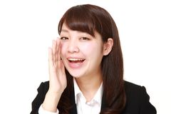 Young Japanese businesswoman shout something. Studio shot of young Japanese woman on white background royalty free stock photos