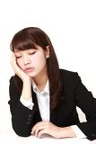 Young Japanese businesswoman sleeping on the desk Royalty Free Stock Images