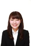 Young Japanese businesswoman smiles Royalty Free Stock Image
