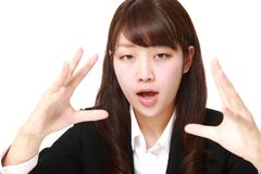 Young Japanese businesswoman with supernatural power Royalty Free Stock Photo