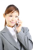 Young Japanese businesswoman talking on smart phone Royalty Free Stock Image
