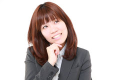 Young Japanese businesswoman thinks Royalty Free Stock Photo