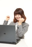 Young Japanese businesswoman in a victory pose Stock Photography