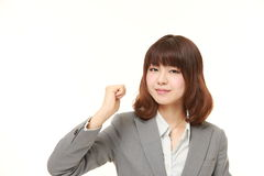 Young Japanese businesswoman in a victory pose Royalty Free Stock Image