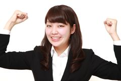 Young Japanese businesswoman in a victory pose Stock Photos