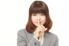 Young Japanese businesswoman whith silence gestures Royalty Free Stock Photography