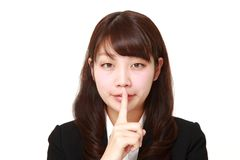 Young Japanese businesswoman whith silence gestures Stock Photos
