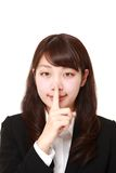 Young Japanese businesswoman whith silence gestures Royalty Free Stock Image