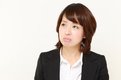 Young Japanese businesswoman worries about something. Concept shot of young Japanese businesswoman`s lifestyle royalty free stock photo