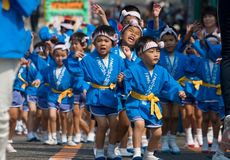 Young Japanese children dancing at a festival Royalty Free Stock Image