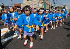 Young Japanese children dancing at a festival Royalty Free Stock Images